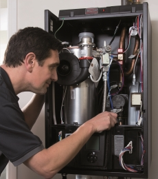 Domestic engineer working on boiler