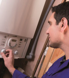 Domestic installer working on boiler